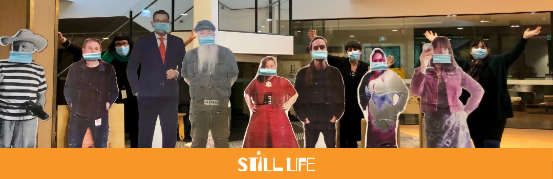 Staff at Burrinja Cultural Centre put masks on cardboard cutouts