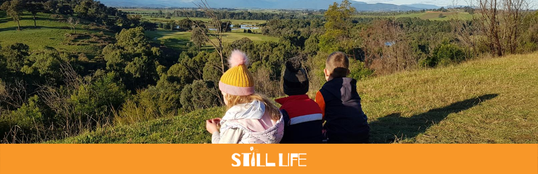 Three kids look over the Yarra Valley.