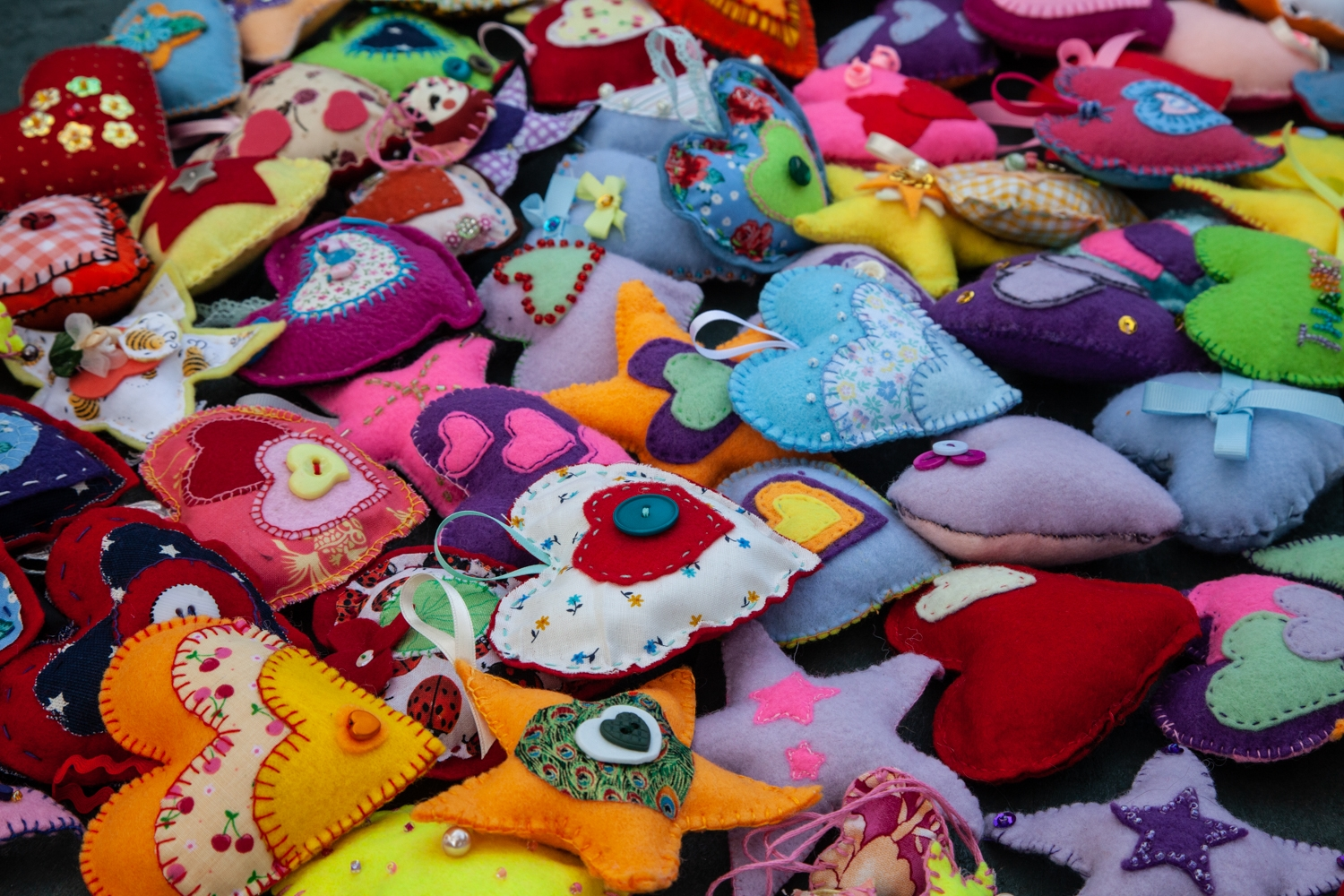 A collection of handmade felt hearts.