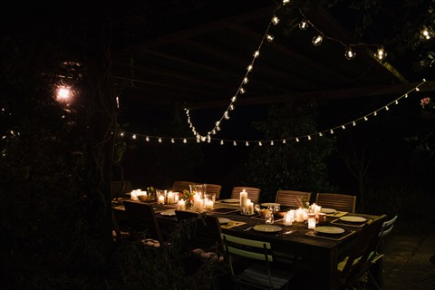 Outdoor table with fairy lights at night