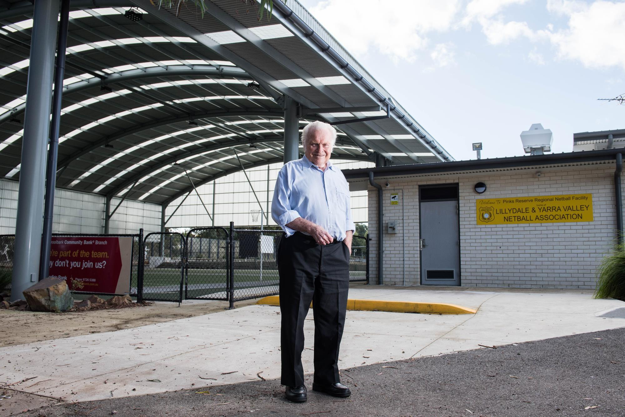 Cr Len Cox in front of netball facilities in Pinks Reserve