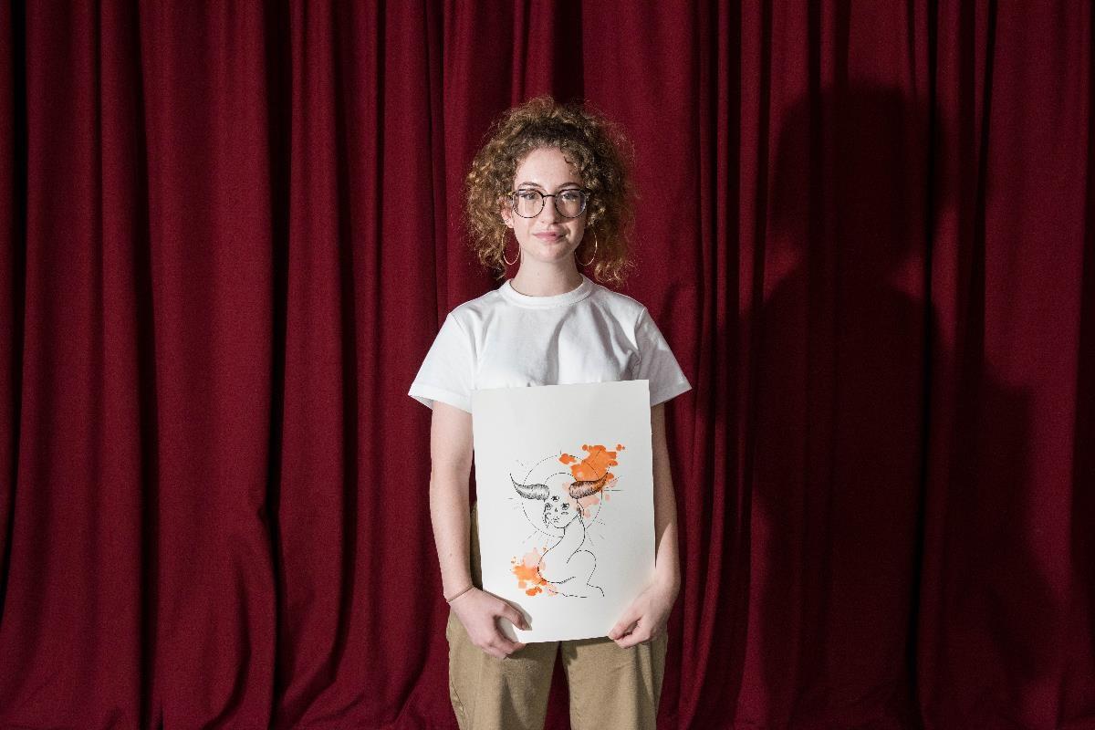 Gianna, an Upwey Artist, with their work.