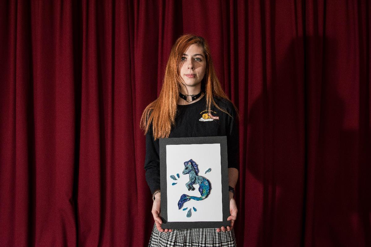 Lilydale Heights College student, April, with their work.