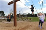 Children playing on the swings at Kimberley Reserve