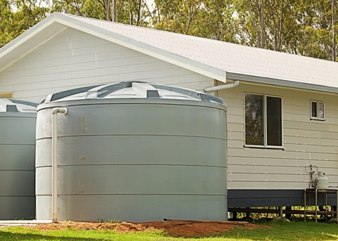 rain water tanks next to a house