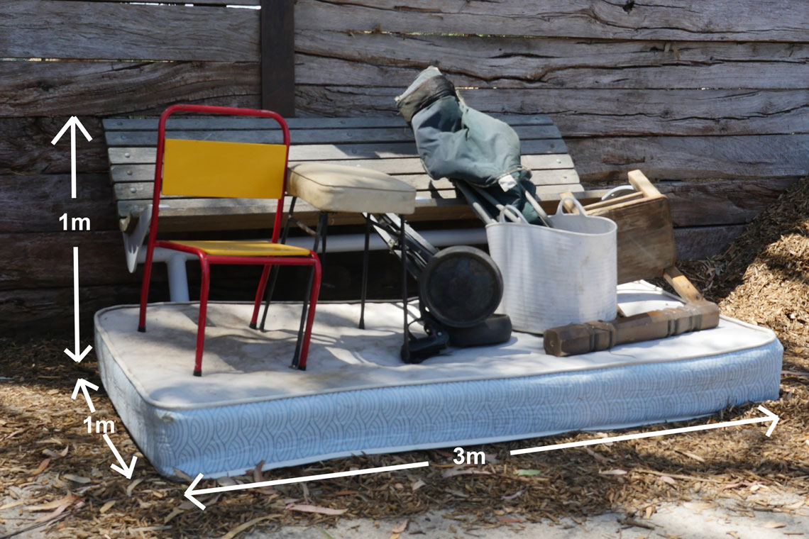 Pile of hard waste including mattress and chair, showing three cubic metres in size